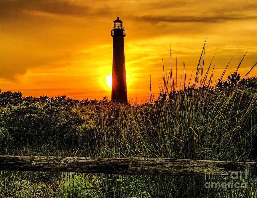 Lighthouse at Sunset by Nick Zelinsky
