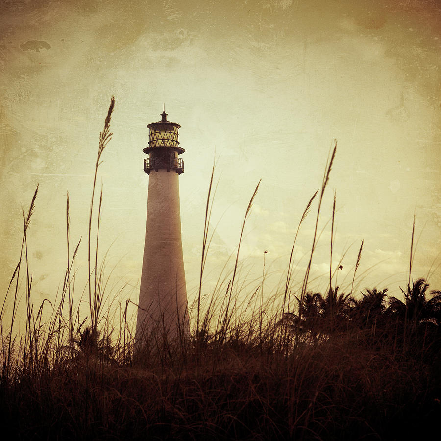 Lighthouse At Sunset Photograph by Thepalmer