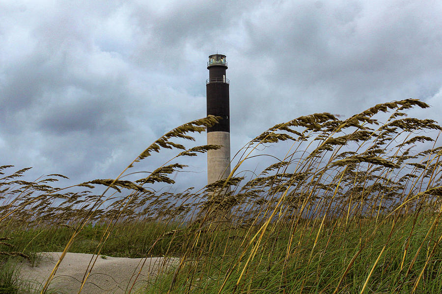 Lighthouse Through The Grasses Photograph