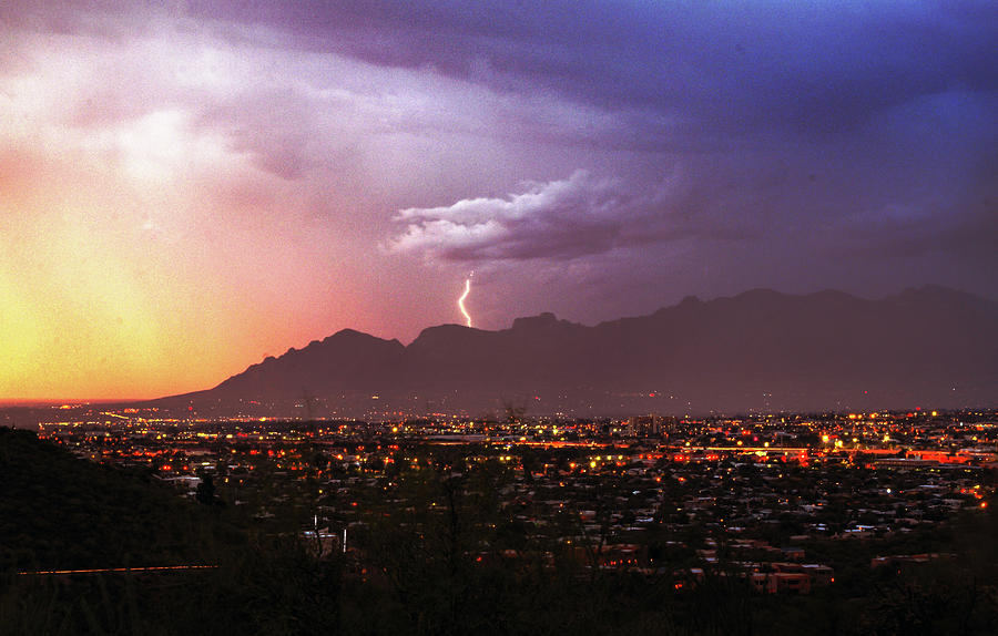 Lightning bolt over the Santa Catalina Mountains and Tucson, Arizona by Chance Kafka