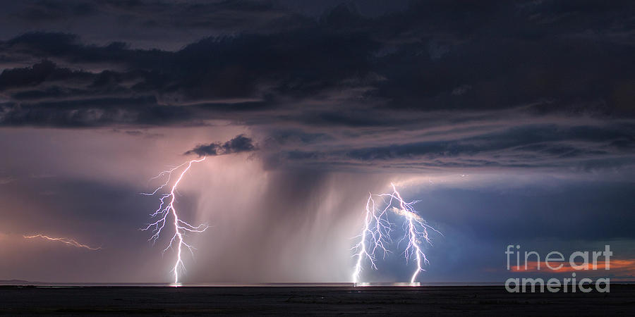 Lightning and downpouring storm passing over the Great Salt Lake by Spencer Baugh