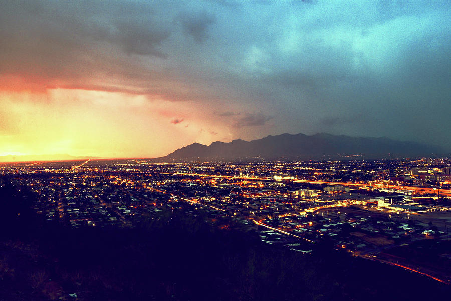 Lights of Tucson, Arizona during Monsoon Sunset Rains by Chance Kafka