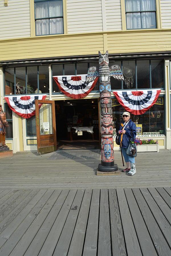 Linda alongside Totem Pole by Joe Smiga