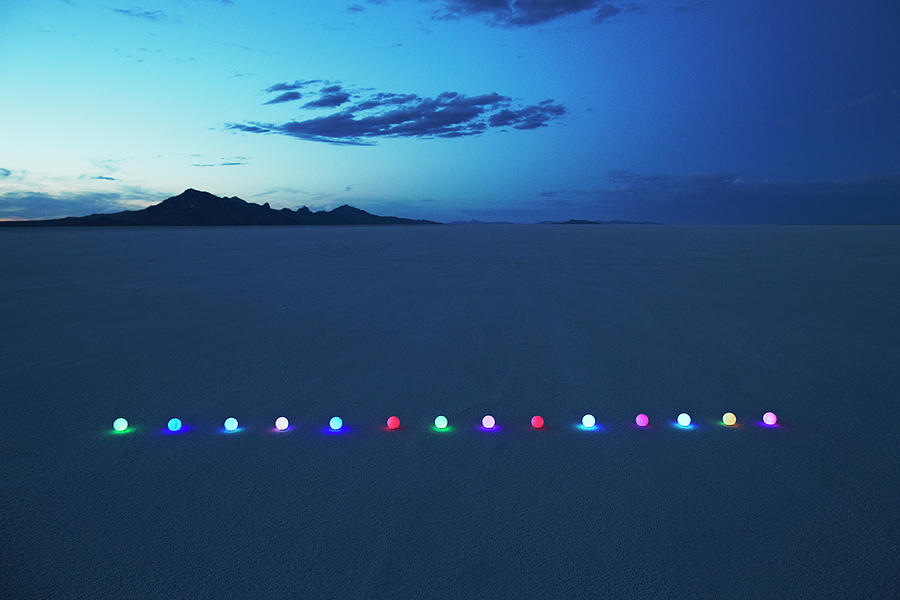 Scenic Photograph - Line Of Glowing Orbs In Desert At Dusk by Andy Ryan