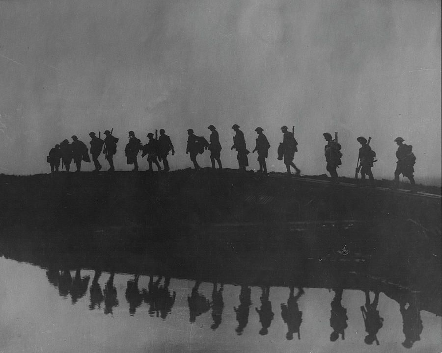 Line Of Marching Soldiers On Ridge Silho Photograph by Time Life Pictures