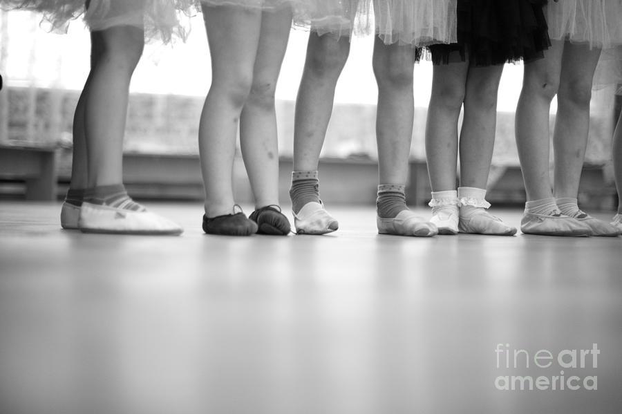 Feet Photograph - Little Ballerinas Legs Standing In A by Anna Jurkovska
