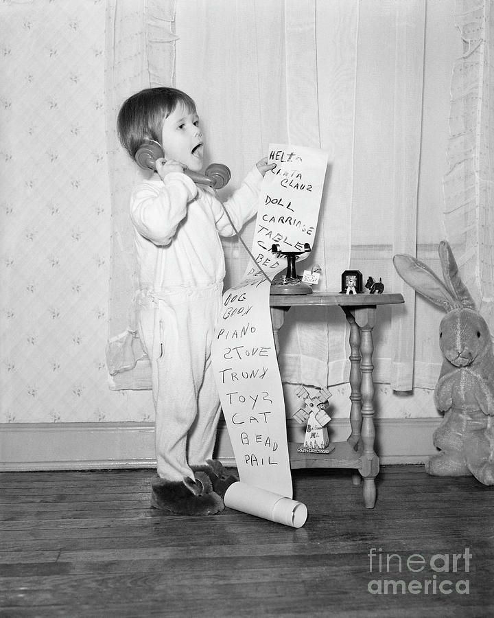 Little Girl On The Phone To Santa Photograph by Bettmann
