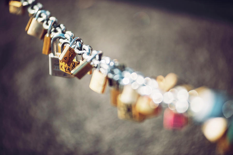Locked locks of love and loyalty, with the names and date  by Eduardo Huelin