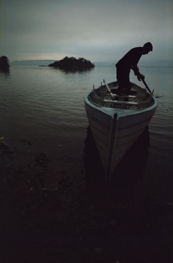 People Photograph - Lone Rower At Shore by Epics
