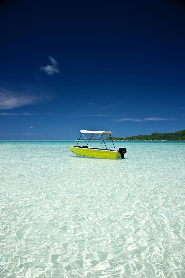 Lonely Boat In Turquoise Lagoon Photograph by Mlenny