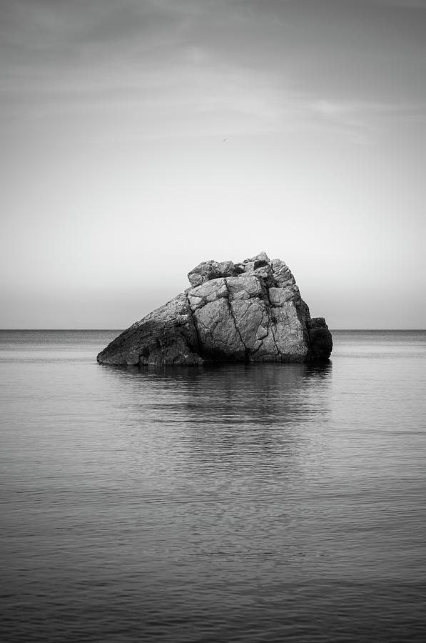 Lonely rock in a cove of Portinatx, Ibiza, Spain by Vicen Photography