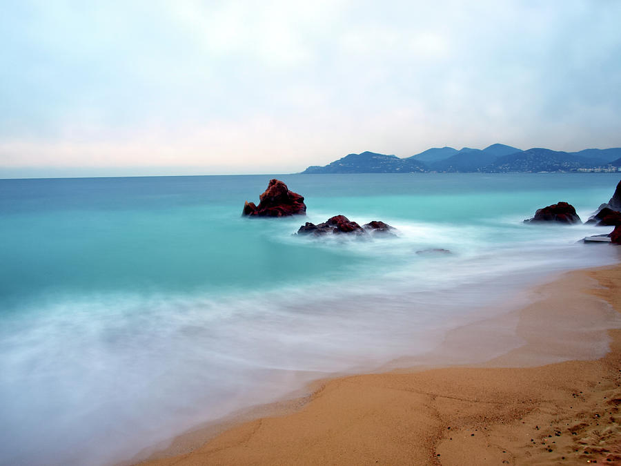 Scenic Photograph - Long Exposure Of Blue Sea by Federica Fortunat