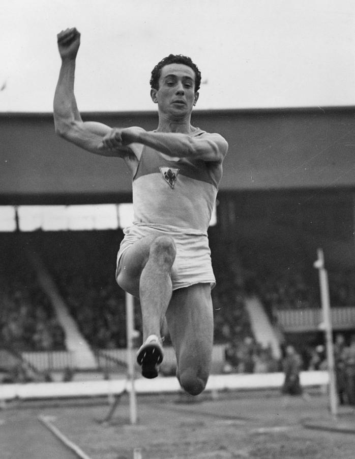Long Jump Winner Photograph by Reg Speller