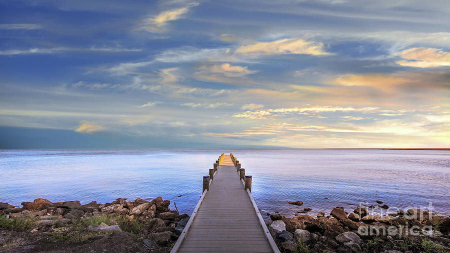 Long narrow pier protruding out into Chesapeake Bay at sunset by Patrick Wolf