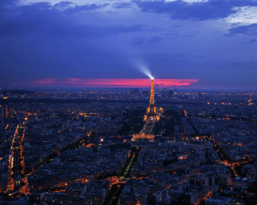 Looking down on Paris and the Eiffel Tower at Sunset by Toby McGuire