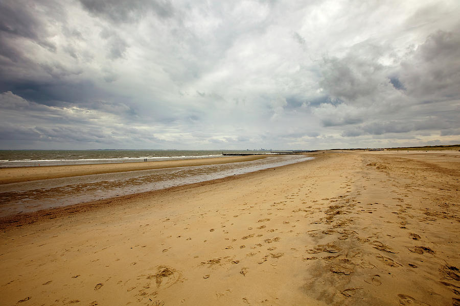 Loomy Sky Over Beach Wide Angle Shot On Photograph by Noctiluxx