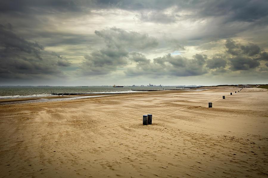 Loomy Sky Over Wide Angle Beach Photograph by Noctiluxx