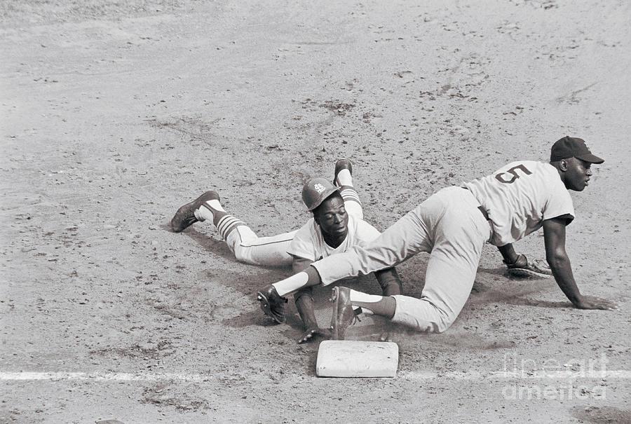 Lou Brock Sliding Into First Base Photograph by Bettmann