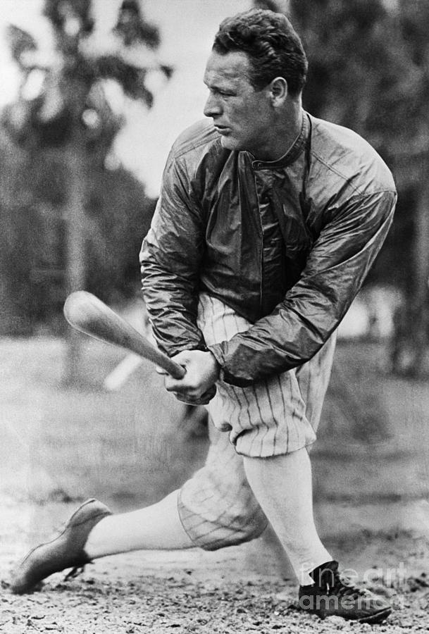Lou Gehrig In Jacket Swinging Photograph by Bettmann