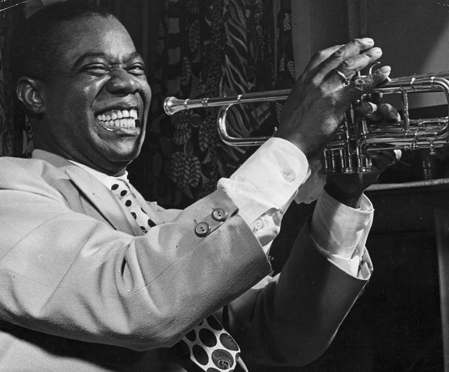 Louis Armstrong Holding Trumpet Photograph by Bettmann
