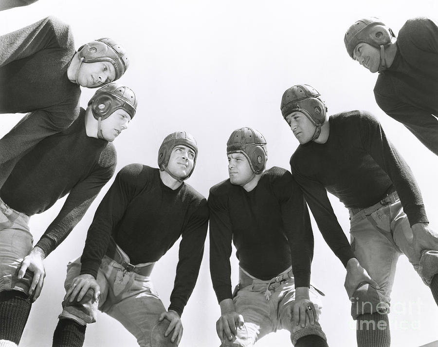 Hands Photograph - Low Angle View Of Football Huddle by Everett Collection