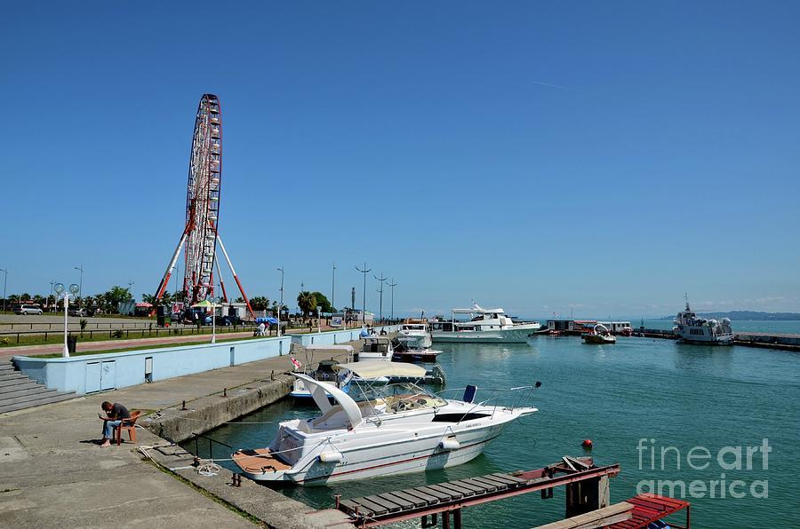 Luxury boats and vessels with ferris wheel flyer ride  at Black Sea marina Batumi Georgia by Imran Ahmed
