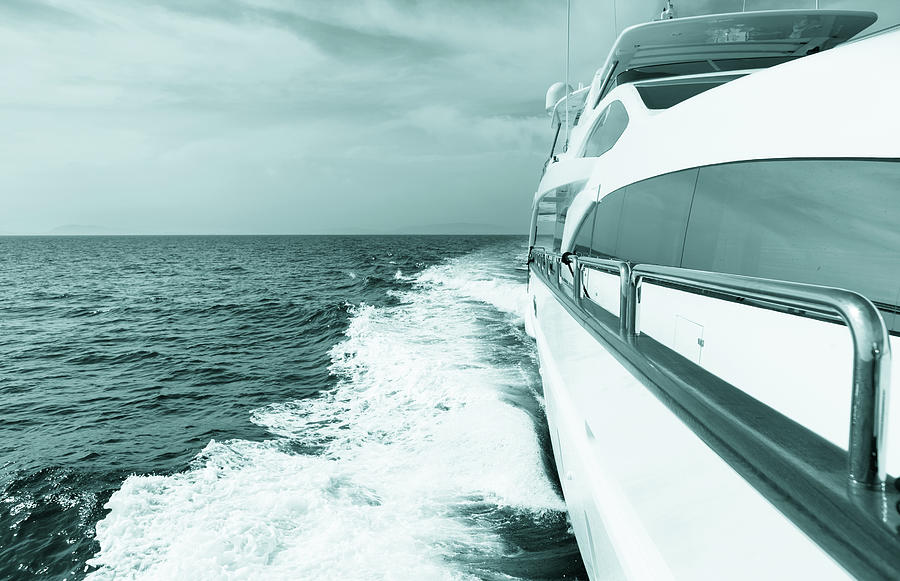 Luxury Yacht Sailing At Sea. Blue Toned Photograph by Petreplesea