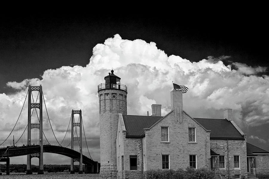 Mackinac Bridge and the Mackinaw City Lighthouse in Black and White by Randall Nyhof