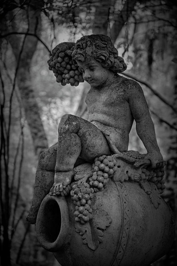 Garden Photograph - Magnolia Child Statue by Jon Glaser