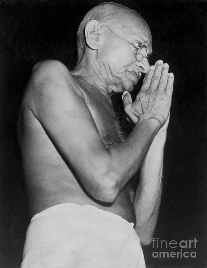 Mahatma Gandhi Praying Photograph by Bettmann