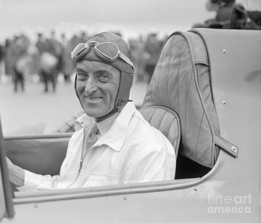 Malcolm Campbell Smiling In Racecar Photograph by Bettmann