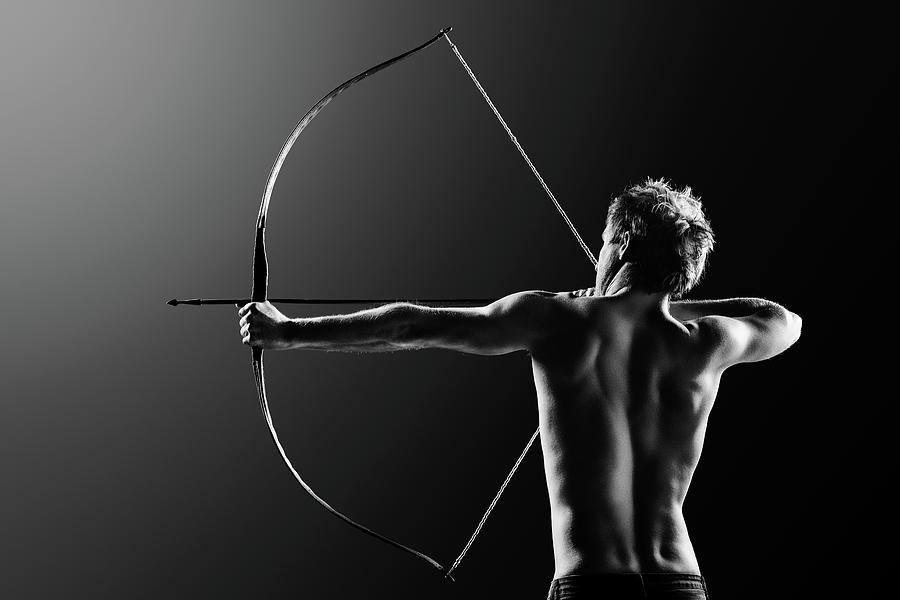 Male Archer Drawing Long Bow Photograph