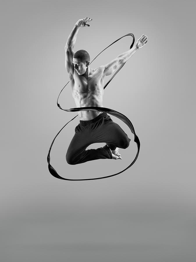 Male Athlete Jumping In Liquid Splsh Photograph by Jonathan Knowles
