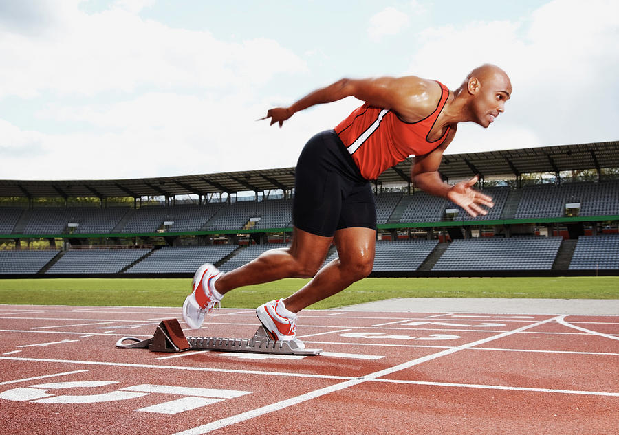 Male Athlete On The Starting Line Of Photograph by Globalstock
