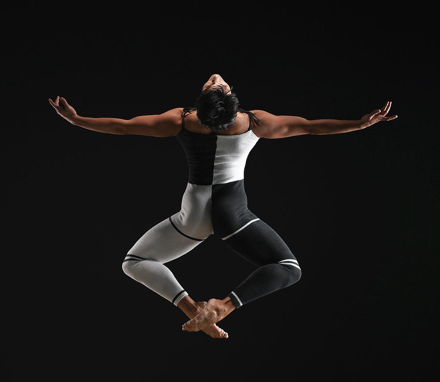 Male Ballet Dancer In Mid Air Pose Photograph by Ryan Mcvay