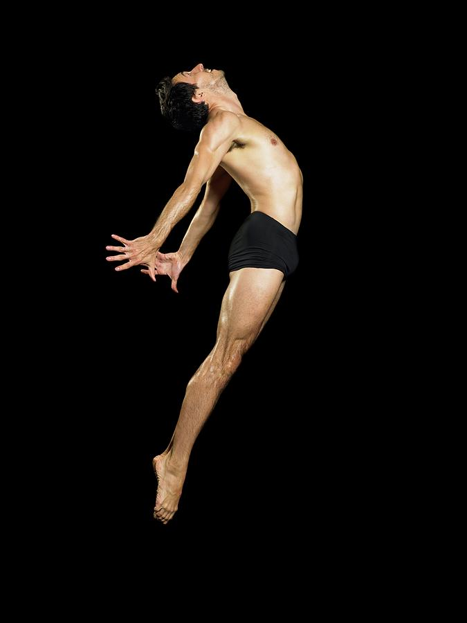Male Dancer Jumping Photograph by Image Source