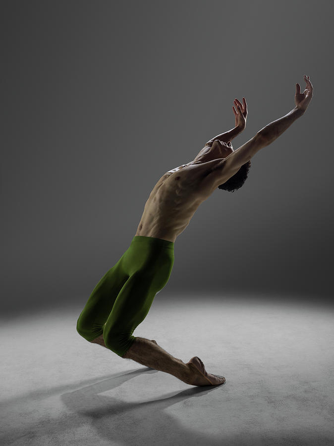 Male Dancer Performing Elevation Over Photograph by Nisian Hughes