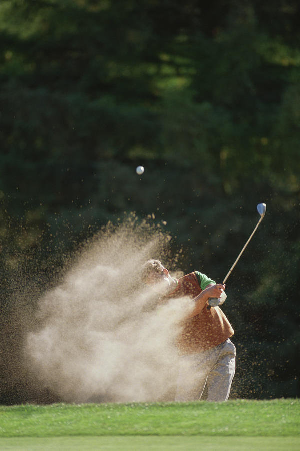 Male Golfer Hitting Out Of A Sand Trap Photograph by David Madison