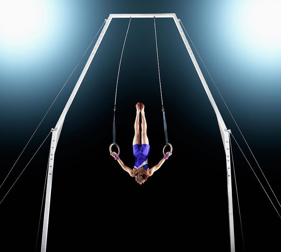 Male Gymnast Upside Down Performing On Photograph by Robert Decelis Ltd