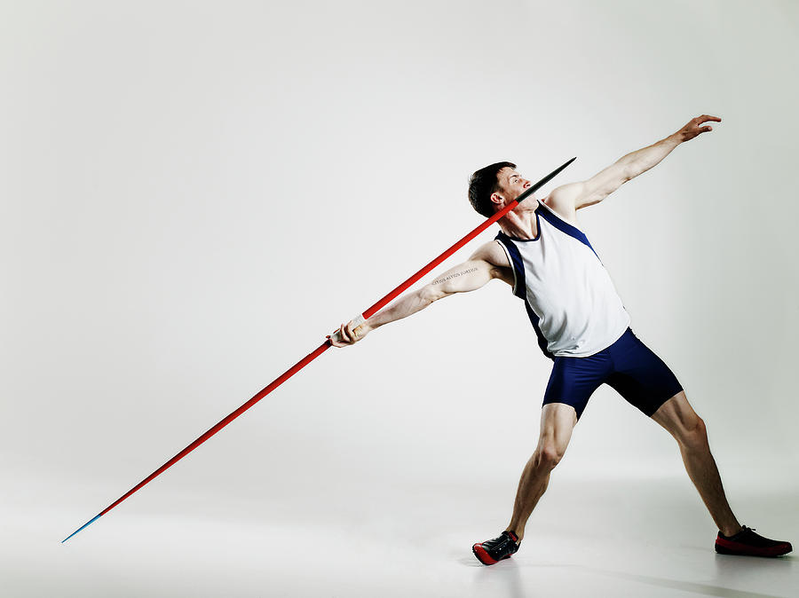 Male Track Athlete Preparing To Throw Photograph by Thomas Barwick