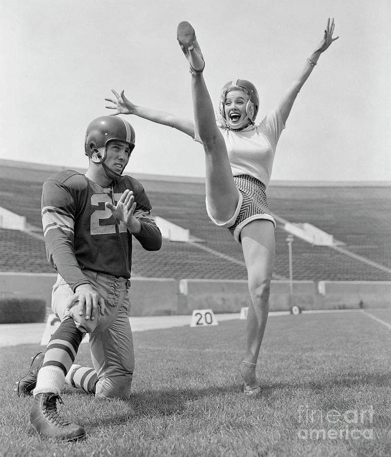 Mamie Van Doren Kicking On Football Photograph by Bettmann