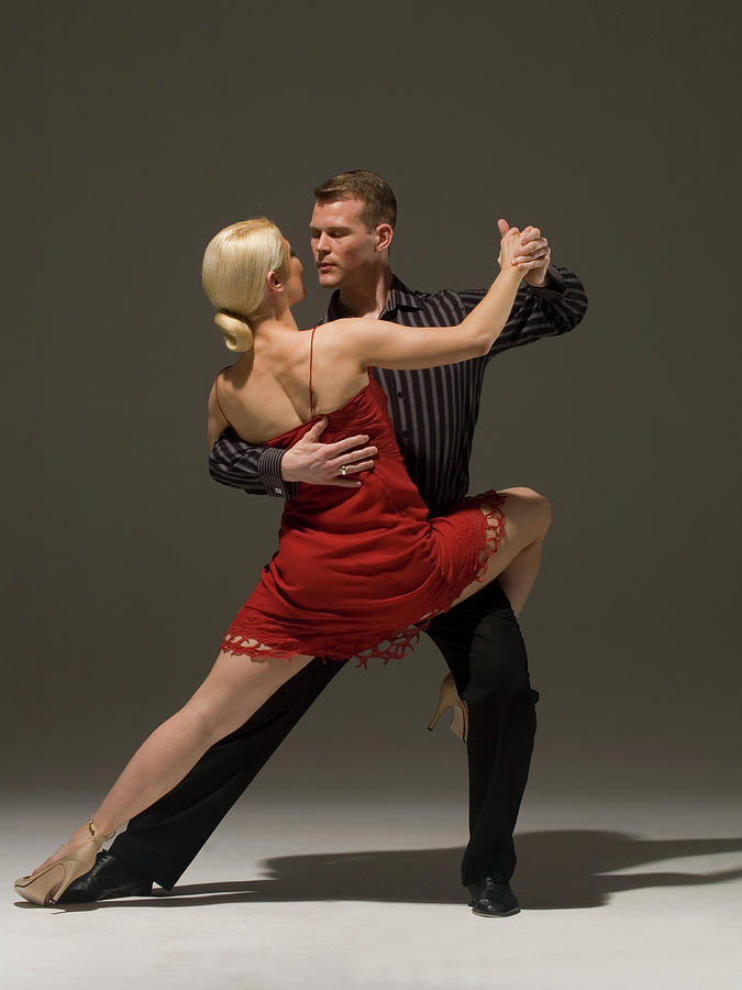 Man And Woman Dancing Tango Photograph by Pm Images