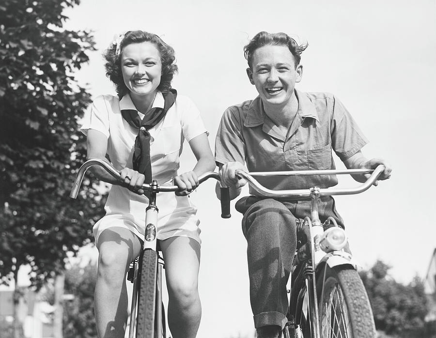 Man And Woman Riding Bikes, B&w, Low Photograph by George Marks