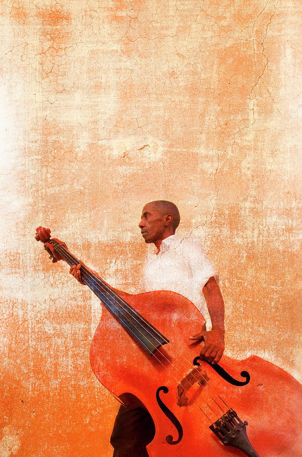 Man Carrying Double Bass Photograph by Grant Faint