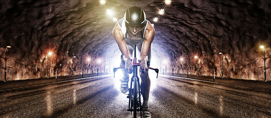 Man Cycling Through Tunnel Photograph by Johner Images