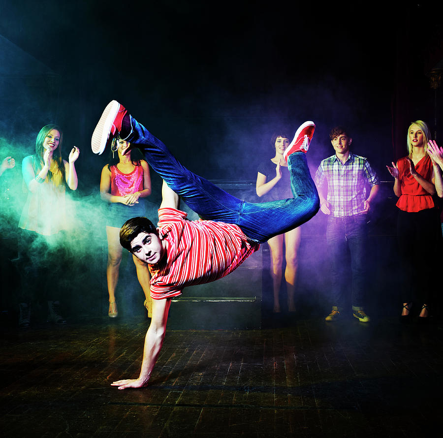 Man Dancing In Front Of A Crowd Of Photograph by Flashpop