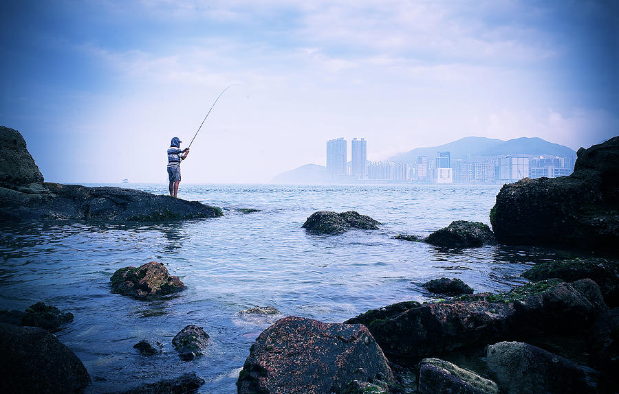 Man Fishing In Victoria Harbour Photograph by Nick Kee Son