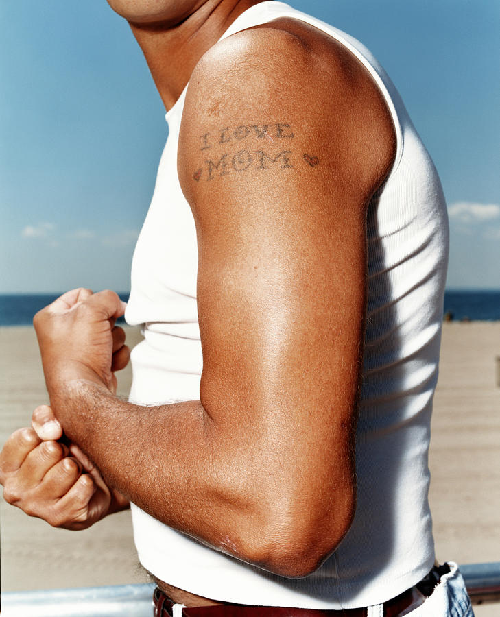 Man Flexing Arm With Tattoo Reading Photograph by Erin Patrice Obrien