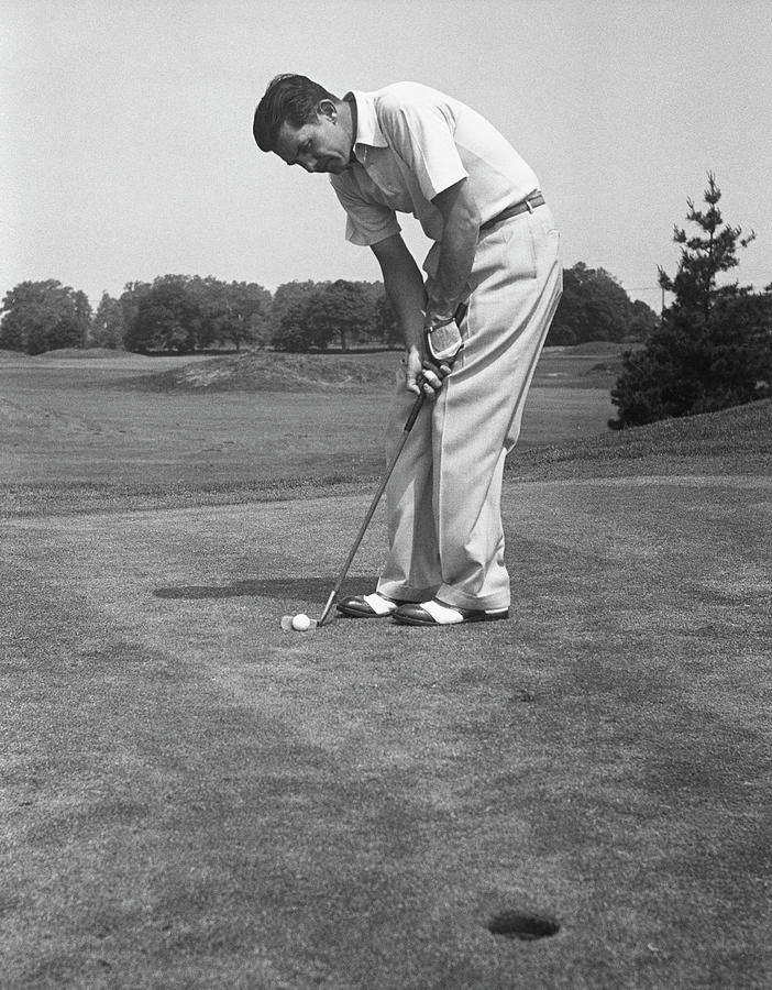 Man Golfing Photograph by George Marks