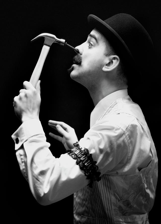 Man Hammering Nail Into His Face Photograph by David Sacks